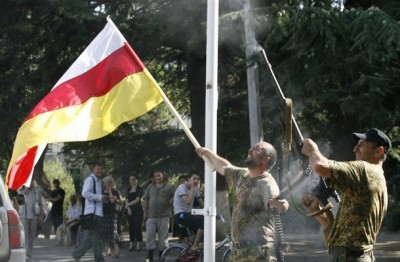 Local militia and residents celebrate Russia's recognition of South Ossetia as an independent state in Tskhinvali